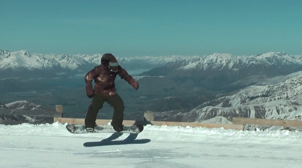completion of jump on snowboard